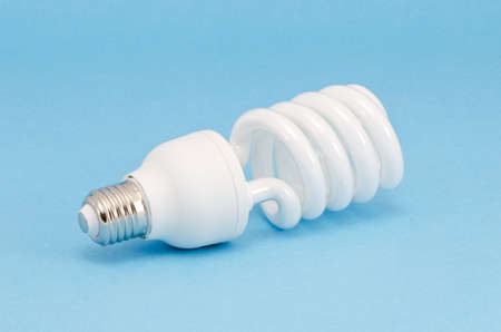 modern energy saving bulb on azure background photo