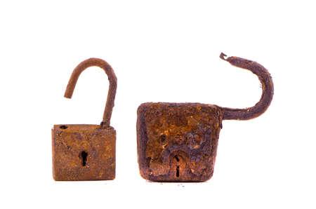 two aged rusty locks isolated on white background photo