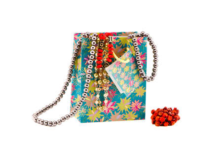 gifts bag with assorted necklaces isolated on white Stock Photo - 16262143
