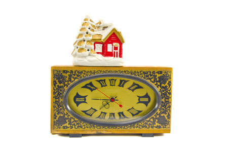 ancient clock and vintage Christmas house isolated on white photo