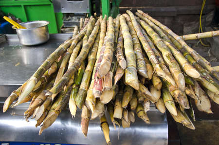 fresh sugarcane on table in Delhi bazaar, India  Stok Fotoğraf