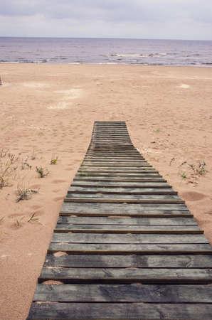 jurmala: wooden track on Baltic sea beach in Jurmala resort, Latvia Stock Photo