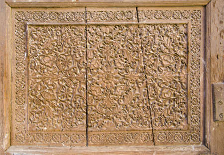 historical carved wooden door background in Jodpur, India photo