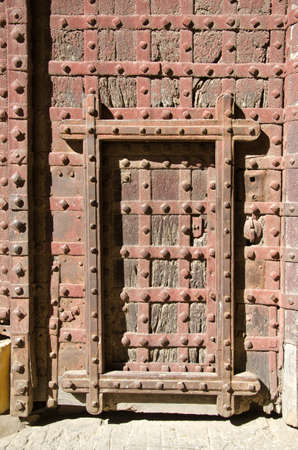 historical Mehrangarh Fort in Jodhpur door background, India photo