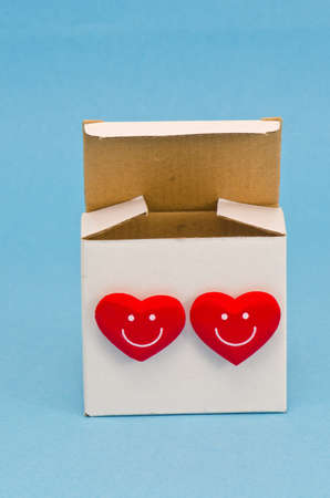 gift box with two red hearts on azure background photo