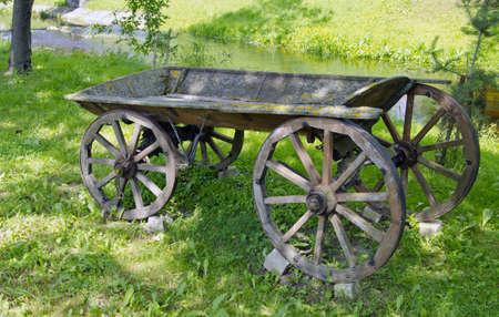 historical and aged wooden carriage in rural park photo