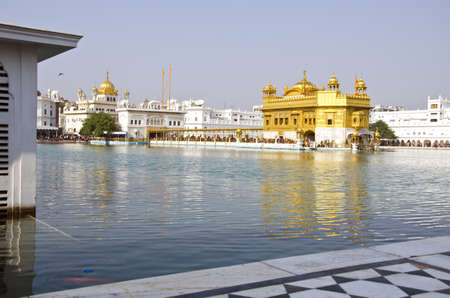 seekhism: sikh Golden temple and sacred pond in Amritsar, Punjab,India Editorial