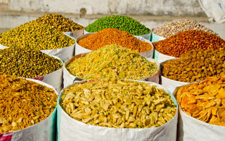 different colorful spices and food in street market, India