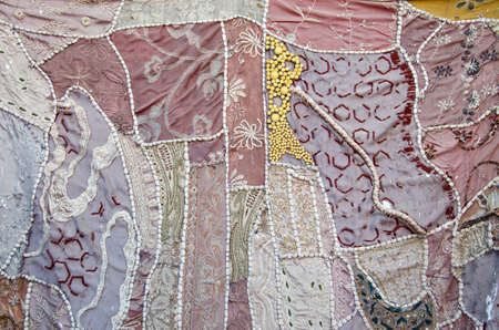 old ornamental indian cloth background and texture photo