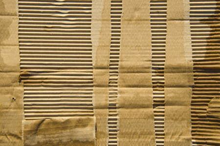 ribbed:  old Textured corrugated striped cardboard background Stock Photo