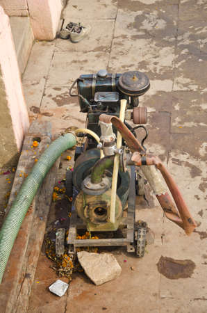 horse pipes: old and grunge generator in Varanasi street, India Stock Photo