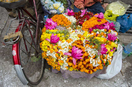 various colorful  flowers religious offerings in Varanasi street market, India photo