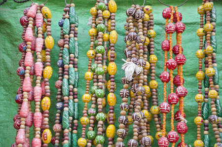 various colorful jewelry in India street market photo