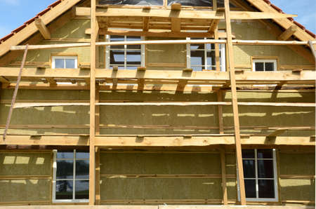 rockwool: new wooden house  exterior thermal insulation with mineral rockwool  Stock Photo