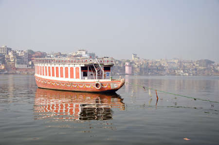 colorful boat on Ganga river in sacred Varanasi city, India