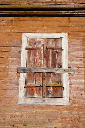 old wooden manor house wall with windows shutter background Stock Photo