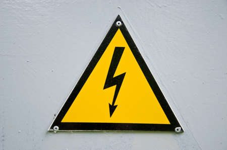 high voltage sign on metal box white background photo