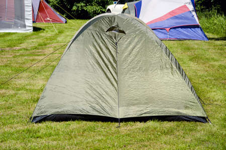 tent camping on summer time grass Stock Photo