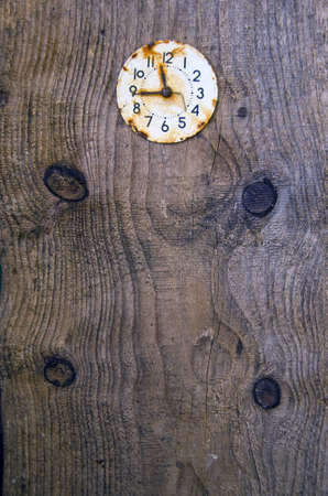 old wooden plank background with ancient clock face photo
