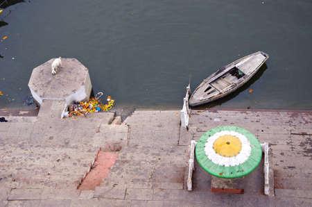 staircase ghat on sacred Ganges river coast in Varanasi, India photo