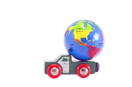 earth globe small model and car toy truck isolated on white. Future concept