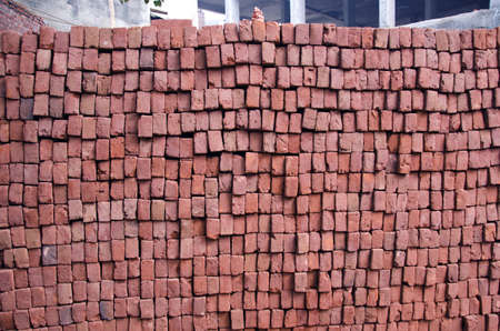 stack of red clay bricks in New Delhi,India photo