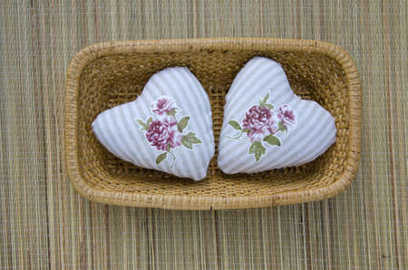 handmade two beautiful clothes heart symbol in wicker plate. Love concept