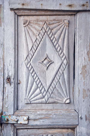 old carved wooden door fragment background, India photo