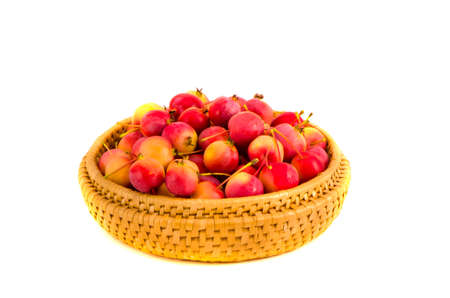 crabapple: fresh crab apples in wooden plate isolated on white background