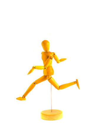 running wooden dummy mannequin for art isolated on white  photo