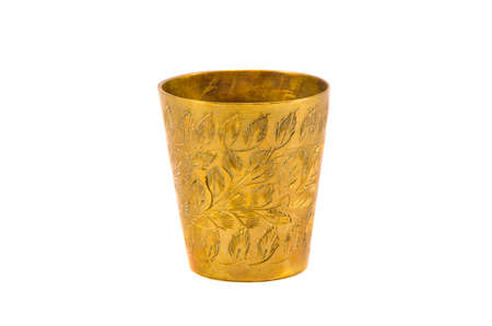 ancient engrave brass cup isolated on white background photo