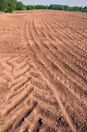 plowed: plowed farm field after rain. Agriculture landscape