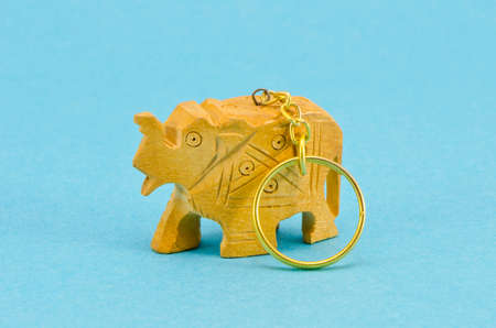key fob: wooden carved asian key fob with metal keyring.Elephant sculpture Stock Photo