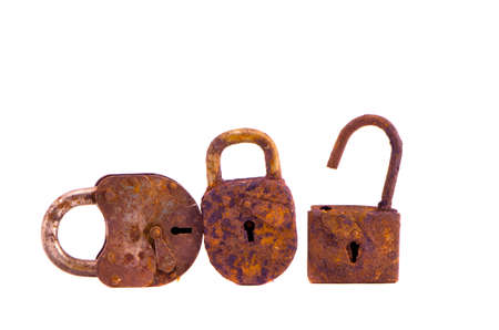 three rusty ancient metal lock isolated on white  photo