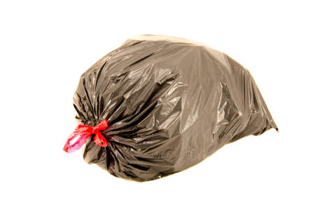isolated full black garbage plastic bag in white background. Rubbish sack photo