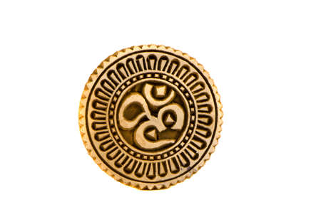 om sign: spiritual hindu om sign wooden carved seal isolated on white