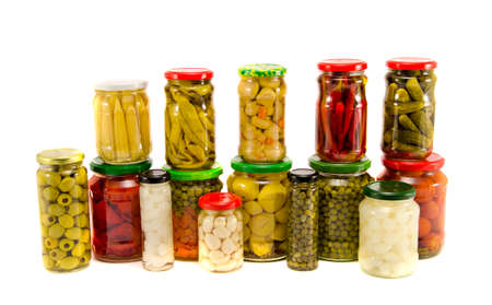 collection various canned vegetables in glass jars isolated on white Banco de Imagens