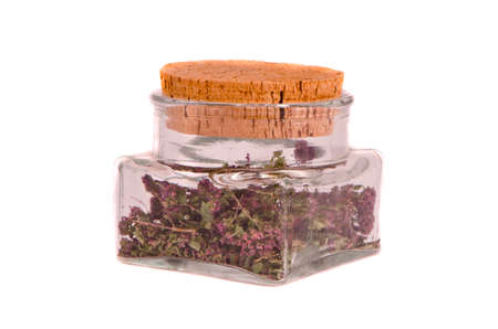 wild marjoram: wild marjoram oregan herb tea in glass bottle isolated on white