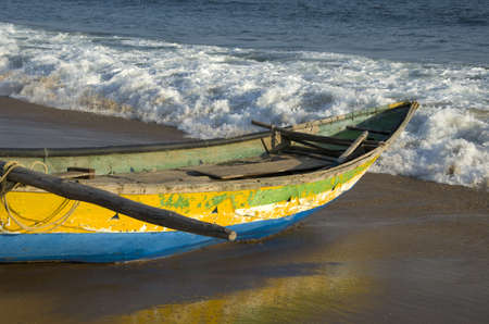 tamilnadu: wooden fishing boat on bengal sea bay beach and wave  in Tamilnadu, India