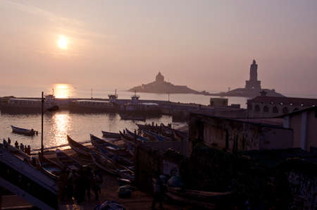 Sunrise at Kanyakumari - Vivekananda Rock Memorial and Thiruvalluvar Statue, India photo
