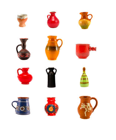 various beautiful ceramic jug and vase collection isolated on white photo