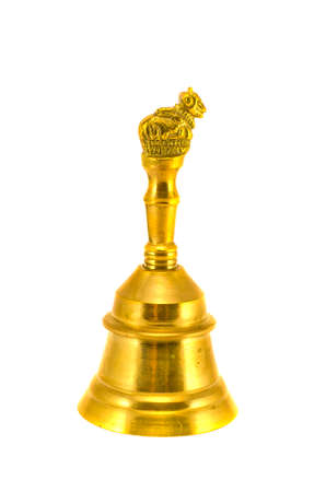 new beautiful golden ornamental asian brass hand bell isolated on white background photo