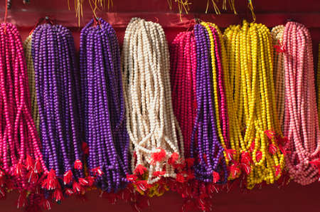 cultural artifacts: colorful buddhists beads rosary near temple in asia, Kathmandu,Nepal