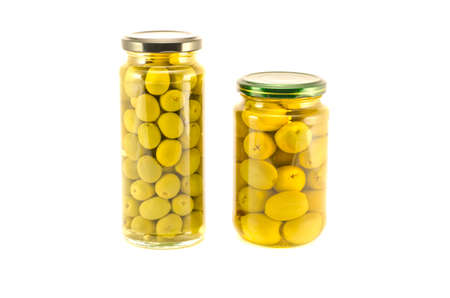Green olives two glass jar isolated on white background