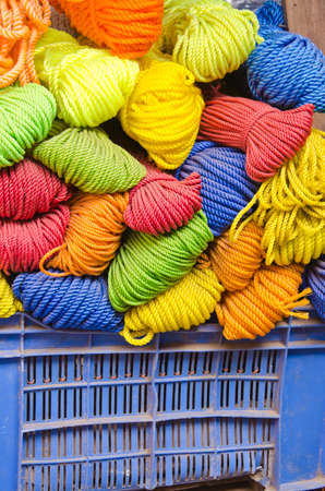 nylon string: colorful nylon string rope in plastic basket - asia street market