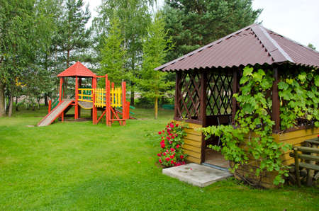 wooden children playground and summerhouse  in summer park