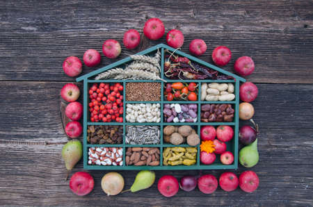 beautiful wooden box with various fruits, nuts and spices. Harvest concept photo