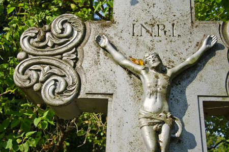 Crucifixion, Jesus Christ on cross in old cemetery photo