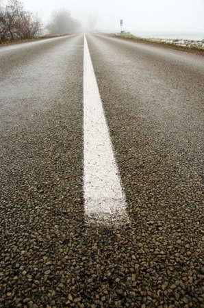 empty rural asphalt road in autumn morning mist fog photo