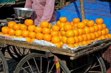 ambulant: fresh orange fruits in asia street market, India